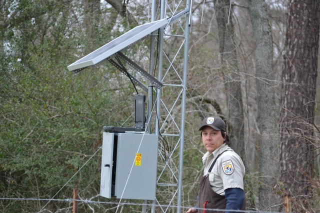 Pete Diaz with the U.S. Fish and Wildlife Service pauses while fine tuning the electronics of one of the antennas that track the movement of paddlefish along the Big Cypress Bayou between Lake O' the Pines and Caddo Lake. This particular antenna is located on private property and demonstrates the cooperation of the stakeholders involved with the Big Cypress Bayou/Caddo Lake Sustainable Rivers Program.