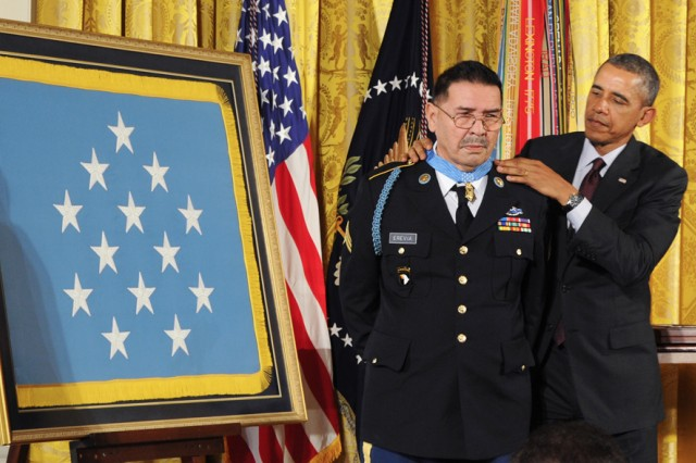 Twenty-four upgrades from Distinguished Service Crosses to Medals of Honor were awarded to Soldiers from three wars at a White House ceremony March 18, 2014. Of the 24 who fought in World War II, Korea and Vietnam, just three are living, all from the Vietnam War.