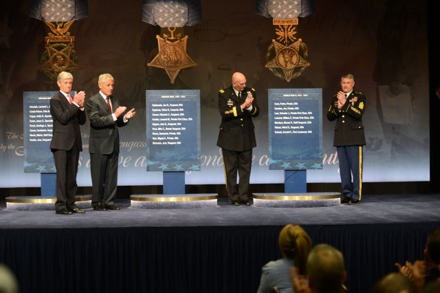 (left to right) Secretary of the Army John McHugh, Secretary of Defense Chuck Hagel, Chief of Staff of the Army Gen. Ray Odierno, and Sgt. Maj. of the Army Raymond F. Chandler III, induct the newest Medal of Honor recipients into the Pentagon Hall of Heroes, March 19, 2019.