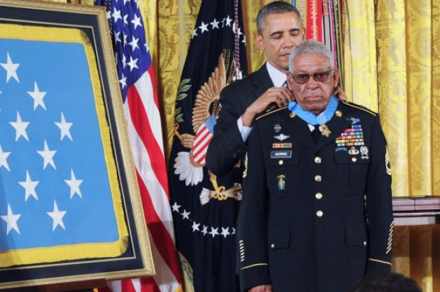 President Barack Obama awards the Medal of Honor to retired Sgt. 1st Class Melvin Morris during a ceremony at the White House, March 18, 2014. Twenty four veterans from World War II, the Korean War, and the Vietnam War, had their Distinguished Service Cross medals upgraded to Medals of Honor. Of the 24 who fought in World War II, Korea and Vietnam, just three are living, all from the Vietnam War, including Morris.