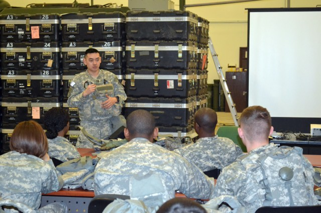 Capt. Frederick H. Do, commander, Headquarters and Headquarters Detachment, 41st Signal Battalion, 1st Signal Brigade, reminds Soldiers to take vehicle rollover training seriously by sharing his experience in Iraq where vehicle roll-overs occurred frequently.