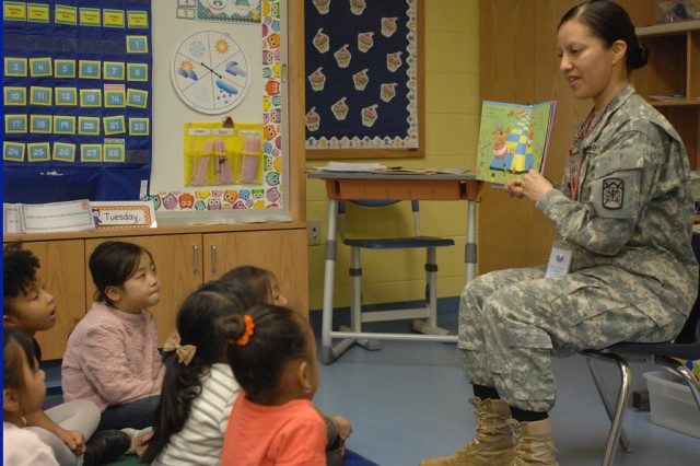 "Spc. Georgina C. Terriquez, assigned to 557th Military Police Company, 94th Military Police Battalion, was one of many volunteers to take part in the Humphreys Central Elementary School's ""Hats Off to Reading with the Cat in the Hat,"" March 3-7. The school celebrated its annual ""Read Across America with Dr. Seuss"" by having adult volunteers share their favorite childhood book or story to students in Kindergarten through Fifth Grade."" U.S. Army photo by William Kim"