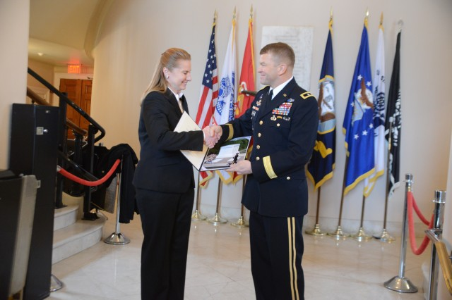 Maj. Gen. Jeffrey S. Buchanan, Joint Force Headquarters-National Capital Region/U.S. Army Military District of Washington commanding general, presents Kathy A. Michalko, U.S. Secret Service Washington Field Office special agent in charge, with a token of appreciation following an Army Full Honors Wreath laying ceremony at the Tomb of the Unknown Soldier in Arlington National Cemetery, Va., March 19, 2014.