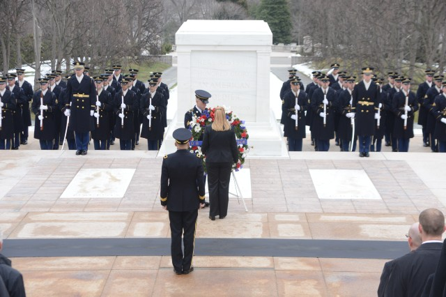U.S. Secret Service Washington Field Office Special Agent in Charge Kathy A. Michalko (left), lays a wreath at the Tomb of the Unknown Soldier during an Army Full Honors Wreath laying ceremony in Arlington National Cemetery, Va., March 19, 2014.