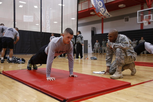 Staff Sgt. Gilberto Perez, a competitor assigned to the 8/98th Regiment, 4th Brigade, 94th Training Division, completes the push-ups portion of the physical fitness test during the 80th Training Command Best Warrior Competition at Fort Knox, Ky., Mar. 18, 2014. (U.S. Army photo by Pfc. Jamill Ford/Released)