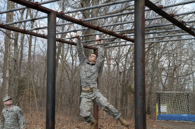 Staff Sgt. Justin Wright, a competitor assigned to the 2nd Brigade, 100th Training Division, finishes the obstacle course during the 80th Training Command (TASS) Best Warrior Competition at Fort Knox, Ky., Mar. 19, 2014. (U.S. Army photo by Staff Sgt. Emily Anderson/Released)