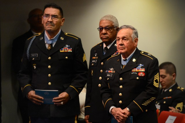 "Vietnam War veterans and Medal of Honor recipients, (left to right)  Spc4 Santiago Erevia, Staff Sgt. Melvin Morris, and Sgt. 1st Class Jose Rodela get applause from the audience during the �""Valor 24"" Hall of Heroes induction ceremony at the Pentagon March 19, 2014.  (DoD Photo by Marvin Lynchard)"