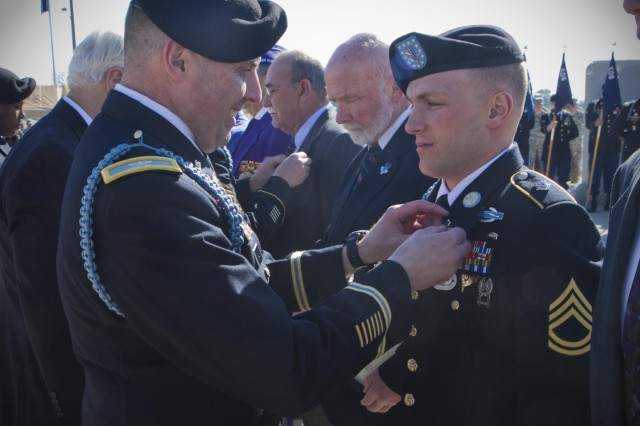 U.S. Army Sgt. 1st Class Billy R. Weiland, a Soldier with 1st Battalion, 506th Infantry Regiment, 4th Brigade Combat Team, 101st Airborne Division (Air Assault), was pinned with the Currahee crest by Col. Val C. Keavney Jr., commander of the 4th BCT, 101st Abn. Div., while being inducted as a Distinguished Member of the 506th Infantry Regiment, during a ceremony March 13,2014. (U.S. Army photo by Sgt. Justin A. Moeller, 4th Brigade Combat Team Public Affairs)