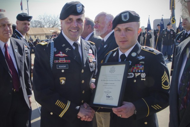 U.S. Army Sgt. 1st Class Billy R. Weiland, a Soldier with 1st Battalion, 506th Infantry Regiment, 4th Brigade Combat Team, 101st Airborne Division (Air Assault), was presented a certificate by Col. Val C. Keavney Jr., commander of the 4th BCT, 101st Abn. Div., formally inducting him as a Distinguished Member of the 506th Infantry Regiment, during a ceremony March 13,2014. (U.S. Army photo by Sgt. Justin A. Moeller, 4th Brigade Combat Team Public Affairs)