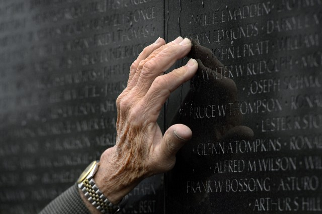 The Vietnam Veterans Memorial reflects the hand of Medal of Honor recipient retired Master Sgt. Jose Rodela in Washington, D.C., March 19, 2014.  President Barack Obama awarded Rodela the medal a day earlier.