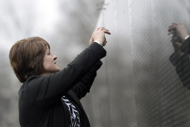 Buffy Evans, niece of the late Medal of Honor recipient Army Spec. 4 Ardie R. Copas, takes a photo at the Vietnam Veterans Memorial Wall in Washington, D.C., March 19, 2014.