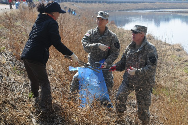 "DONGDUCHEON, South Korea "" Soldiers from the 210th Field Artillery Brigade and 1st Armored Brigade Combat Team, 2nd Infantry Division joined citizens of Dongducheon, South Korea in the annual Shincheon River Clean-up March 21, 2014. U.S. Soldiers and members of the community worked side-by-side to make a positive impact on the environment while continuing to build strong relationships with each other. Brig. Gen. Paul J. Laughlin, 2nd Inf. Div. deputy commanding general for maneuver, and Mayor Oh Sea-chang, Dongducheon city mayor, were the guest speakers for the event.  (U.S. Army photos by 210th Field Artillery Brigade Public Affairs Team/Released)."
