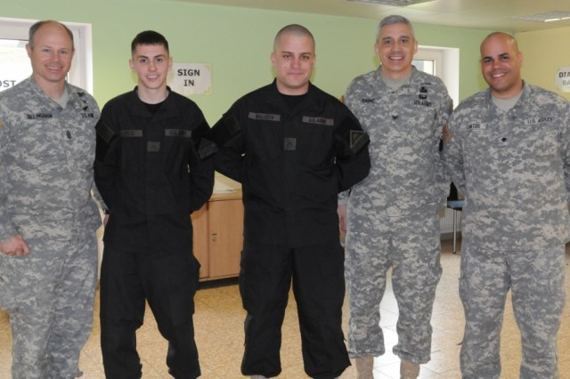 Leadership and volunteers gather at the grand opening of the ACS Family Center for Little Troopers at Hohenfels, March 19. (From left to right:Command Sgt. Maj. Jeffrey R. Dillingham, USAG Bavaria command sergeant major, Pvt. Edwin Acevedo and Pvt. James Walczyk, 1-4th Inf. Regt., Col. James E. Saenz, USAG Bavaria commander, and Spc. Jose R. Santos, 1st Military Intelligence Battalion.)