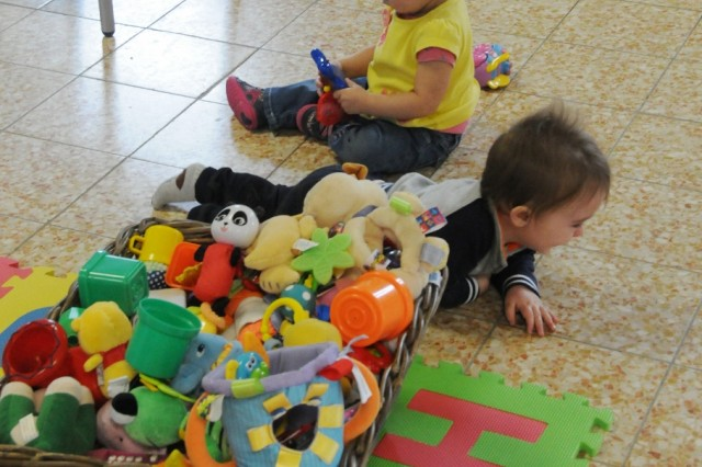 Tiny tots enjoy their toys in the new ACS Family Center for Little Troopers at Hohenfels, March 19.