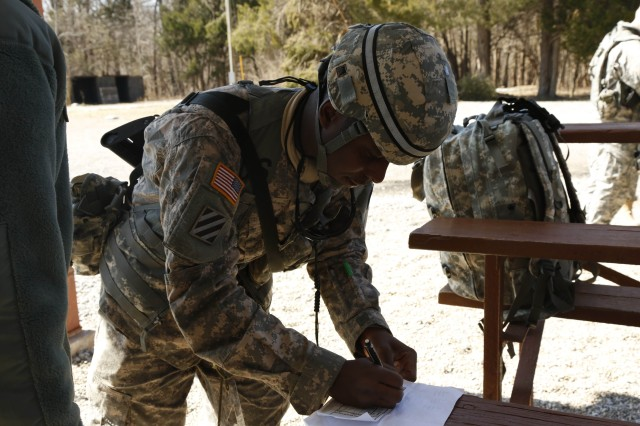Staff Sgt. Ricky Barr, assigned to the 9/108th Regiment, 1st Brigade, 94th Training Division, plots points to begin the land navigation course during the Best Warrior Competition at Fort Knox, Ky., Mar. 20, 2014. (U.S. Army photo by Pfc. Jamill Ford/Released)