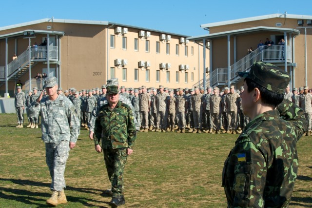 NOVO SELO TRAINING AREA, Bulgaria -- Maj. Gen. Richard C. Longo, Deputy Commanding General of U.S. Army Europe and Brig. Gen. Krasimir Kanev, Deputy Commander of the Bulgarian Land Forces, review troops in formation, including those from Ukraine, during the opening ceremony for Saber Guardian, Mar. 21, 2014. Saber Guardian 2014, hosted by U.S. Army Europe and the Bulgarian Land Forces, is a multinational military exercise involving approximately 700 military personnel from twelve participating nations including Armenia, Azerbaijan, Belgium, Bulgaria, Georgia, Moldova, Poland, Romania, Serbia, Ukraine, Turkey and the U.S., as well as representatives from NATO. The exercise, which runs until April 4, 2014,  is designed to strengthen international agency and military partnering while fostering trust and improving interoperability between NATO and partner nations involved in foreign consequence management and peace support operations with U.S. forces. Saber Guardian 2014 is part of the U.S. Army Europe annual training and exercise program and has been planned for since 2013. Last year's iteration of the training exercise was conducted at the Romanian Land Forces Combat Training Center in Cincu, Romania. The training at Saber Guardian 2014 will reinforce USAREUR commitment to increasing regional flexibility, preserving and enhancing NATO interoperability, and facilitating multinational training.