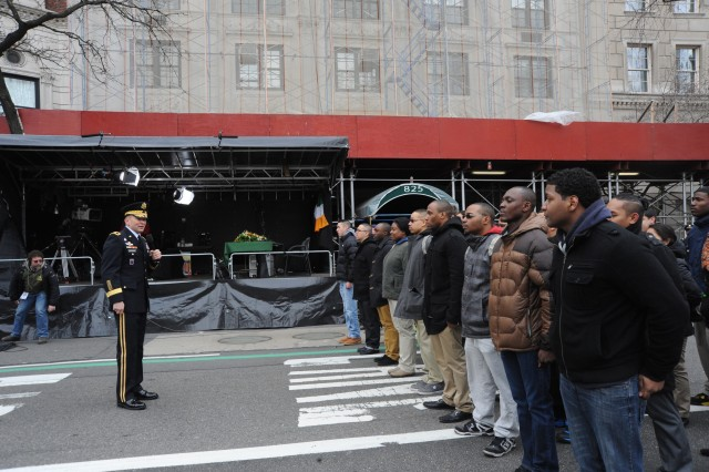 Maj. Gen. Jeffery S. Buchannan, U.S. Army Military District of Washington commanding general, talks with 'Future Soldiers' prior to the swearing in ceremony at the reviewing stand before the start of St. Patrick's Day Parade in New York City, March 17, 2014.