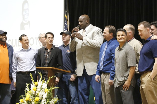 NBA legend and Robert G. Cole High School graduate Shaquille O'Neal (center) is surrounded by his teammates from the 1989 Cougars state champonship team that went 36-0 during the season. O'Neal's No. 33 team jersey was formally retired in a ceremony at the school's gym March 7.