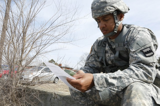 Sgt. 1st Class Marcus Narcisse of the 00th Logistics Support Brigade participates in an Urban Orienteering Course as part of the 80th Training Command Best Warrior Competition hosted by the 100th Training Division at Fort Knox Ky., Mar 20, 2014. (U.S. Army photo by Pfc. Jamill Ford/Released)