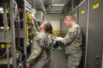Staff Sgt. James Walker how to proficiently conduct self-diagnosis on various signal equipment