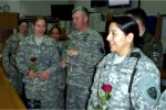 2nd Lt. Julia O'Neil receives a rose from Col. Hensley
