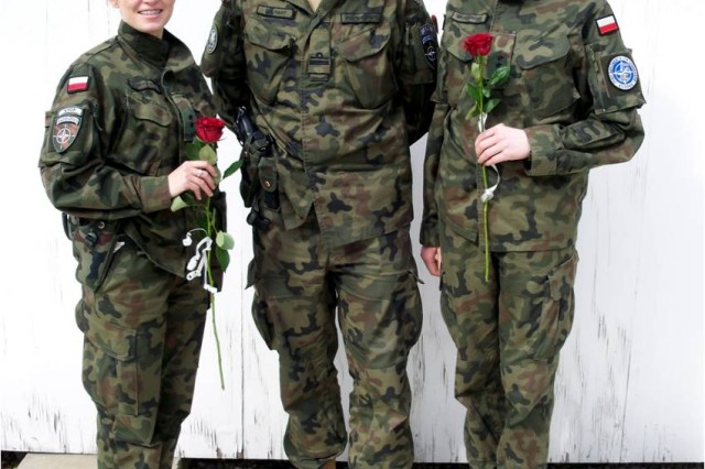 Serving in Kosovo Force's Multinational Battle Group-East are many different nations, and on International Woman's Day, special recognition was given to the female Soldiers serving.   Polish navy Lt. Cmdr. Grunert Krzysztof (middle) was on hand to assist in the recognitions while two Polish army Soldiers, 2nd Lt. Sylwia Klimkiewicz (left) and 2nd Lt. Renata Brzozowska accepted symbolic roses of appreciation from the command and staff of MNBG-E.