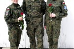 Polish female soldiers pose with ceremony's leader at Camp Bondsteel, Kosovo