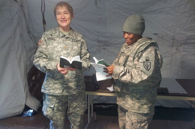Unit Ministry Team SSG Latonia Harris & Chaplain (Major) Susan Caswell of the 201st Battlefield Surveillance Brigade at Joint Base Lewis-McChord. This UMT is pictured in the field in support of the Tomahawk MRE, to certify two BN UMTs for upcoming deployment.