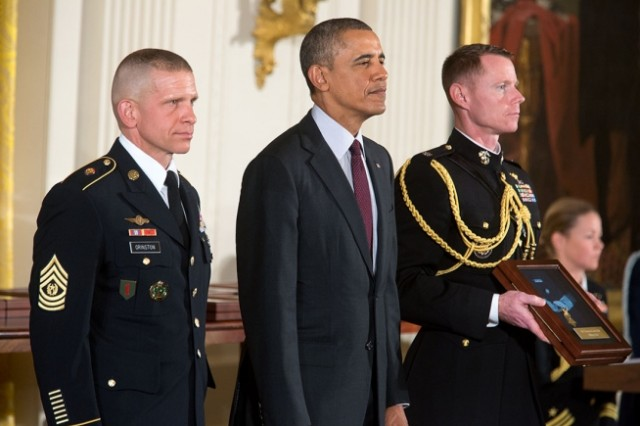 Command Sgt. Maj. Michael A. Grinston, the 1st Inf. Div.'s senior noncommissioned officer, accepted the Medal of Honor from the president on behalf of Sgt. Candelario Garcia, Company B, 1st Battalion, 2nd Infantry, 1st Brigade, and his family. Grinston was one of two active-duty Soldiers accepting the Medal of Honor for those who have passed away. (Official White House Photo by Chuck Kennedy)