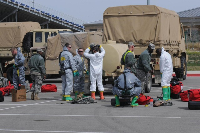 Soldiers with the 44th Chemical Company, 2nd Chemical Battalion, 48th Chemical Brigade, prepare to conduct mass-casualty decontamination exercise March 19, 2014, on Fort Hood, Texas. The unit is currently on the Defense CBRNE (Chemical, Biological, Radiological, Nuclear and Explosive) Reactionary Force mission. The reactionary force deploys to any domestic CBRNE catastrophic event.