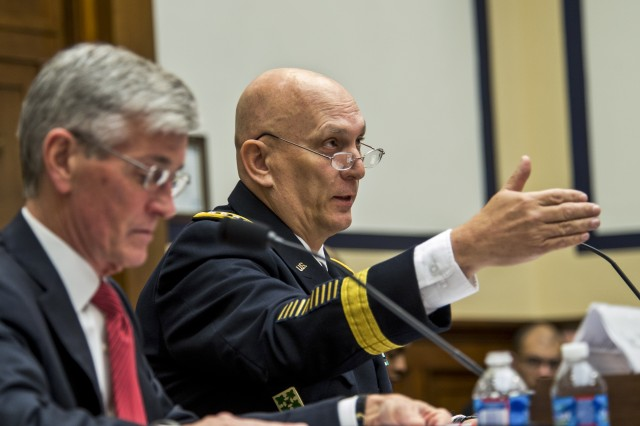 Army Chief of Staff Gen. Ray Odierno answers a question from members of the House Armed Services Committee during a hearing as Army Secretary John M. McHugh listens, in Washington, D.C., March 25, 2014.