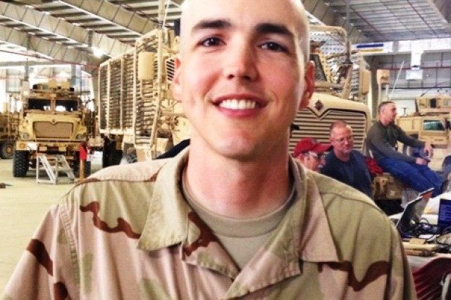 David Hullinger, a human factors engineer with the Tank-automotive and Armaments Command field element, in Warren, Mich., sports a shaved his head. He decided to try out a new look while deployed to Afghanistan and surprised his wife via Skype.