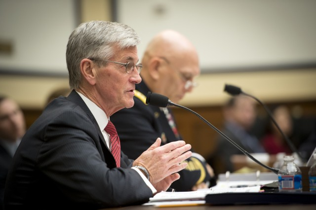 Army Secretary John M. McHugh answers a question from members of the House Armed Services Committee during a hearing as Army Chief of Staff Gen. Ray Odierno listens, in Washington, D.C., March 25, 2014.