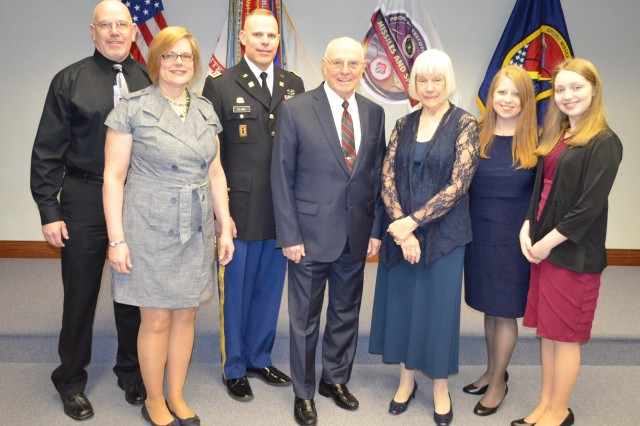 Lt. Col. Todd Cline, of the Cruise Missile Defense Systems Project Office, celebrates his retirement March 19 with his family members. From left are his brother Erik, sister Vicki Lieberman, Cline, his father Donald, mother Darlene, wife Jeanine and daughter Sabrina.