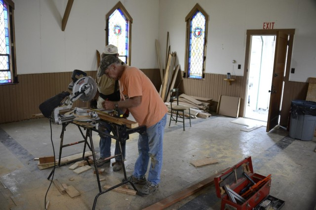 Volunteers from the 201st RED HORSE Squadron Alumni Association, which includes former members of the Pennsylvania Air National Guard's 201st RED HORSE, are renovating one of the installation's historic chapels. (U.S. Army National Guard/released)