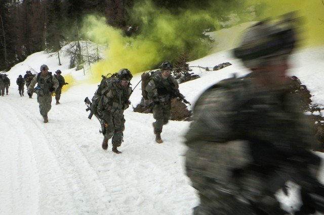 Soldiers from the 1st Battalion (Airborne), 503rd Infantry Regiment, run to assault enemy forces during a mission readiness exercise at Reiteralpe, March 18, 2014. Soldiers from the 503rd Infantry conducted an air assault mission with the 12th Combat Aviation Brigade. (U.S. Army photo by Sgt. Jacob Sawyer)