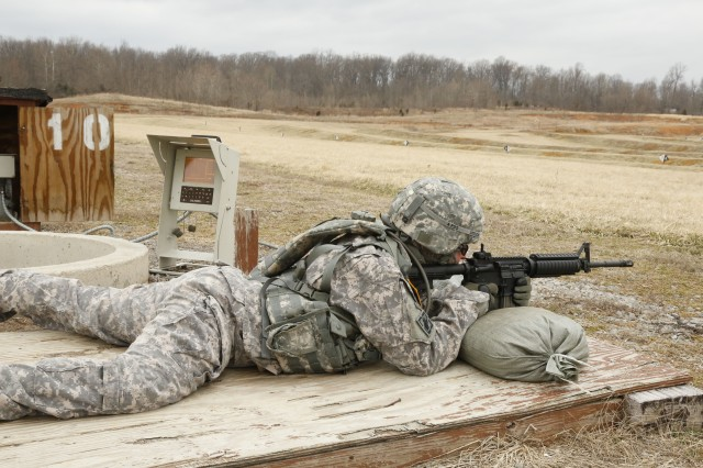 Staff Sgt. Kathleen (Amy) Justice, a competitor assigned to the 7/95th Regiment, 4th Brigade, 94th Training Division, aims her weapon during the weapons qualification event during the Best Warrior Competition at Fort Knox, Ky., Mar. 20, 2014. (U.S. Army photo by Pfc. Jamill Ford/Released)