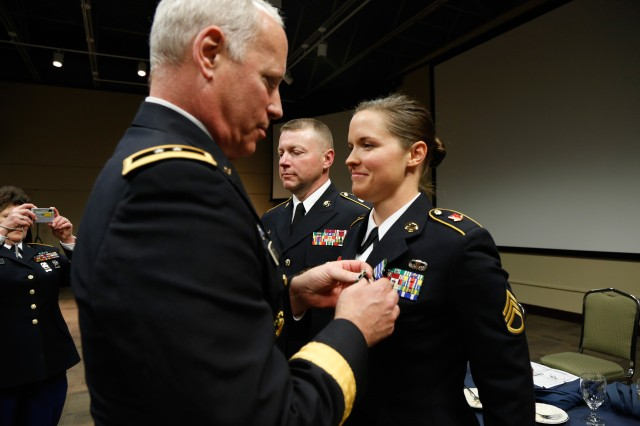 Maj. Gen. Bill Gerety, Commander, 80th Training Command (TASS), awards Staff Sgt. Amy Justice, 7/95th Regiment, 4th Brigade, 94th Training Division, the Army Commendation Medal for earning the title of the 80th TC Best Warrior in the noncommissioned officer category. Justice will represent the 80th TC in the United States Army Reserve Command best warrior competition. (U.S. Army photo by Pfc. Jamill Ford/Released)