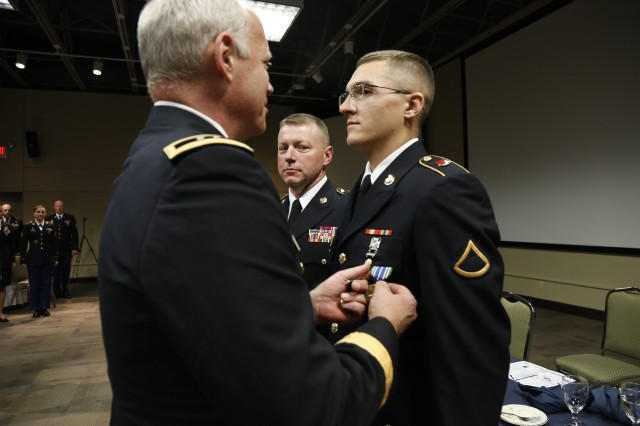 Maj. Gen. Bill Gerety, Commander, 80th Training Command (TASS), awards Spc. Curtis Anderson, 3/95th Regiment, 2nd Brigade, 100th Training Division, the Army Commendation Medal for earning the title of the 80th TC Best Warrior in the enlisted category. Anderson will represent the 80th TC in the United States Army Reserve Command best warrior competition. (U.S. Army photo by Pfc. Jamill Ford/Released)