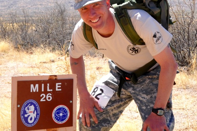 Staff Sgt. Joseph Salkowski, Fort Jackson Warrior Transition Unit, pauses at the 26-mile marker during the Bataan Memorial Death March at White Sands Missile Range, N.M., March 23, 2014.