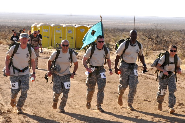 The Fort Jackson military coed heavy team is on its way to a first-place finish at the Bataan Memorial Death March at White Sands Missile Range, N.M., March 23, 2014. The Soldiers finished the 26.2-mile ruck race more than 30 minutes ahead of the second-place team.
