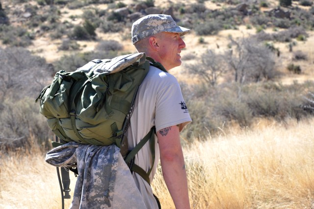Staff Sgt. Joseph Salkowski , Fort Jackson Warrior Transition Unit, is on his way during the Bataan Memorial Death March at White Sands Missile Range, N.M., March 23, 2014.