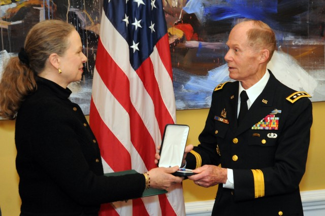 Lt. Gen. Jack Woodall, USA (Ret.), a former commander of the 2nd Infantry Division, presents the Distinguished Service Cross to Pamela Keiser, awarded to her late husband Sgt. 1st Class Robert Keiser, March 25, 2014, for his actions during the Korean War.