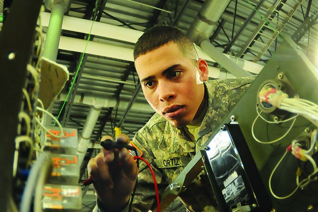Pvt. Felix Ortiz uses a multi-meter to check circuits in a power generator during a recent Power Generation Equipment Repairer Course troubleshooting exercise at Fort Lee, Va. The course is taught using a new instructional method called Skills-Based Training.