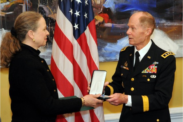 Lt. Gen. Jack Woodall, USA (Ret.), a former commander of the 2nd Infantry Division, presents the Distinguished Service Cross to Pamela Keiser, awarded to her late husband Sgt. 1st Class Robert Keiser, March 25, 2014, for his actions during the Korean War. (U.S. Army photo by Colby T. Hauser, CID Public Affairs)