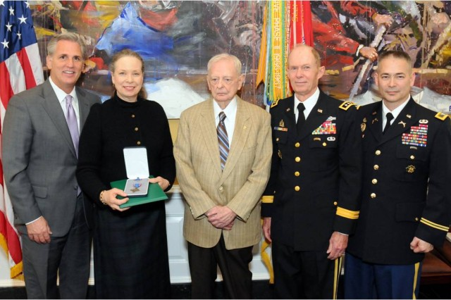 (From left to right) House Majority Whip Kevin McCarthy (R-Calif.), Pamela Keiser, Lou Gregg, Lt. Gen. Jack D. Woodall,USA (Ret.), and Col. Dan McElroy, the Deputy Provost Marshal General of the U.S. Army, at the formal ceremony where Sgt. 1st Class Robert F. Keiser was posthumously awarded the Distinguished Service Cross, March 25, 2014, at the U.S. Capitol Building. (U.S. Army photo by Colby T. Hauser, CID Public Affairs)