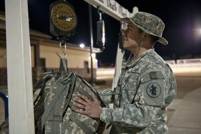 Staff Sgt. Robert Hogeland weighs his rucksack prior to the start of the 25th Bataan Memorial Death March at White Sands Missile Range, N.M. March 23.