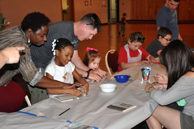 Children, parents and volunteers work with clay March 20 at Fort Jackson's Joe E. Mann Center as part of a support program called Creative Journey, created by the Columbia Parks and Recreation Department and the Fort Jackson Exceptional Family Member Program.