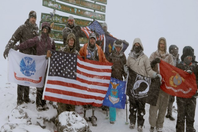 The Kilimanjaro Warriors celebrate reaching the summit of Mount Kilimanjaro, the tallest free-standing mountain in the world. The team of wounded service members and veterans reached the summit on the seventh day of their journey, Feb. 15, 2014. Courtesy photo by Bevan Bell