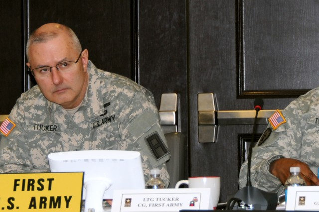 First Army and Forces Command leaders listen to a point being made during a Training Support Synchronization Working Group at First Army headquarters. From left are: First Army Command Sgt. Maj. Sam L. Young; First Army Commanding General, Lt. Gen. Michael S. Tucker; and Maj. Gen. Stephen Twitty, Forces Command deputy chief of staff for operations.